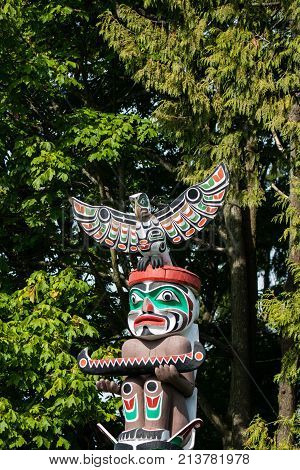 First Nations totem poles located in Stanley park is a popular tourist attraction year around. Representing craftsmanship and unique culture of indigenous people poster