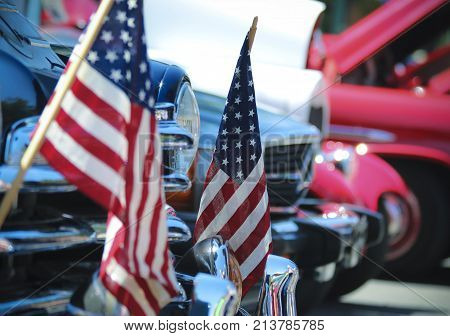 American Flags and Chrome at a Vintage Car Show a Fourth of July Tradition at the Plaza in Santa Fe New Mexico.