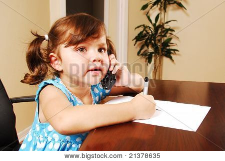 Young Girl In An Office Environment