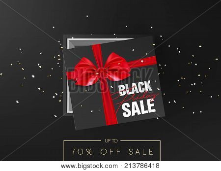 Black friday sale Black cardboard box tied with a red ribbon bow is lying on a black background with confetti and inscription Black friday Top view Template for the poster, banner and web.