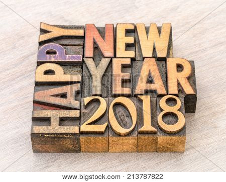Happy New Year 2018 greeting card - text in vintage letterpress wood type blocks on a grained wooden background