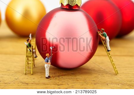 Miniature people worker figures painting christmas balls