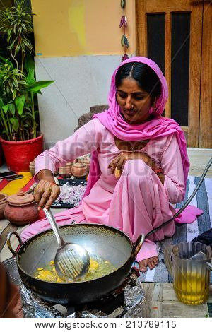 Indian Women Cooking Traditional Food