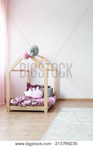 Wooden Bed In Child's Bedroom