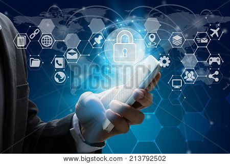 Businessman use smartphone with virtual screen padlock and Interface Icons over the Network connection of World map on technology background Cyber Security Data Protection Business Technology Privacy concept.