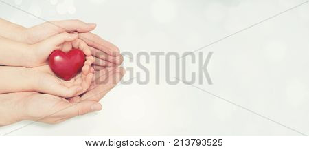 Parent And Child Holding Heart In Hand
