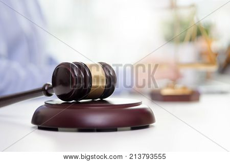 Wooden Gavel, Working Lawyer In Background.