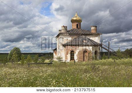 Rural landscape with the restored church of St. Nicholas the Wonderworker in the village of Sredny (Olyushino), Verkhovazhsky district, Vologda region, Russia poster