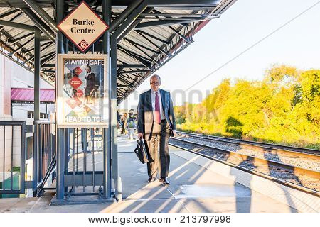 Burke, Usa - October 27, 2017: Businessman Man Walking On Platform For Vre Train To Washington Dc Fo