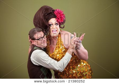 Drag queen and Caucasian nerd on green background hold hands poster