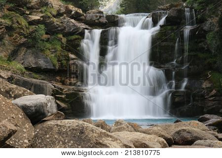 Veil effect on river waterfall in the middle of the forest