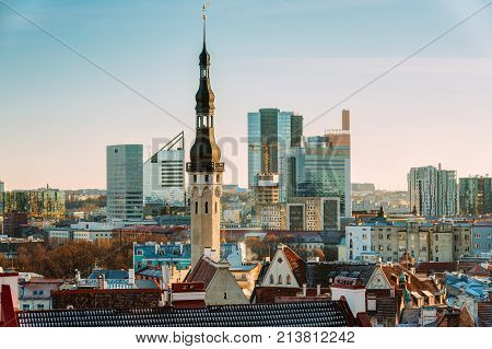 Tallinn, Estonia. Tower Of Tallinn Town Hall On Background Of Modern Architecture. Oldest Town Hall In Baltic Region And Scandinavia. poster
