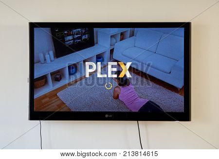 MONTREAL CANADA - NOVEMBER 15 2017: Plex app and logo on LG TV screen. Plex is a client-server media player system and software suite comprising two main components.