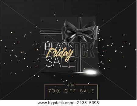 Black friday sale cardboard box tied with a black ribbon bow and lying on a black background with confetti and inscription Black friday Top view Template for the poster, banner and web.
