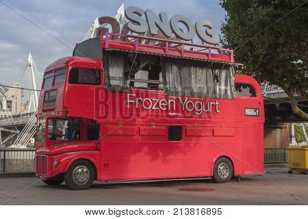 The Queen´s Walk ,London-September 6,2017:The Snog Frozen Yogurt red double decker bus on the Queen´s Walk on September 6 ,2017 in London United Kingdom