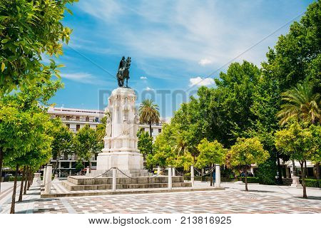 Seville, Spain. Monument to King Saint Ferdinand at New Square Plaza Nueva in Seville, Spain.