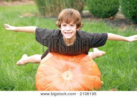 Boy Playing On Pumpkin