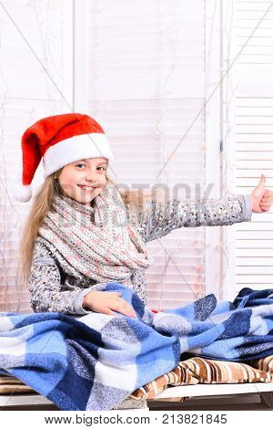 Kid Gets Ready To Winter Holidays. Christmas And Childhood Concept