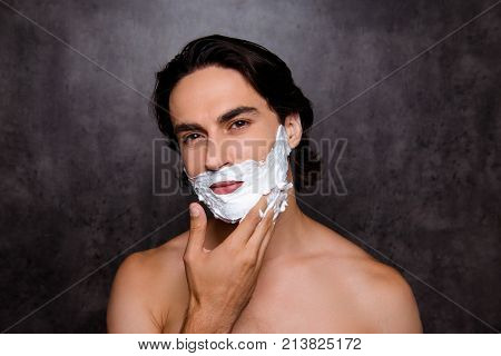 Close Up Of Face Of Cheerful Mulatto Hispanic Man With White Foam On His Face, Isolated On Grey Back