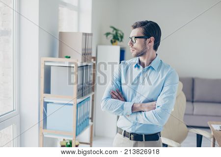 Minded Entrepreneur Standing With Crossed Arms And Looking In The Window. He Is Waiting For His New