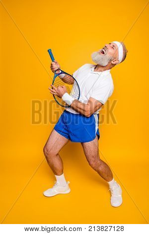 Full Length Of Sexy Emotional Cool Pensioner Grandpa Practising Rock Music On A  Sport Equipment, St