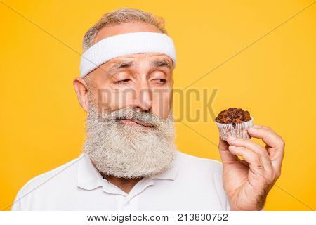 Athlete Cool Uncertain Unsure Ponder Fit Picky Grandpa Holds Forbidden Tasty Yummy Treat, Decides. W