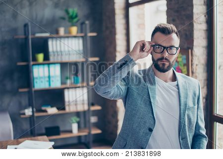 Serious Stylish Ponder Brunet Bearded Broker With Mustache, Looking At The Camera, Standing In A Cas