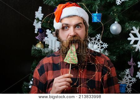 Christmas Man With Beard On Happy Face Lick Lollipop Candy