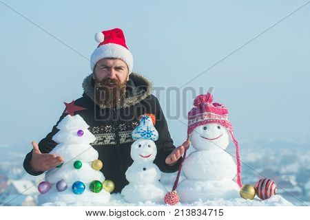 Hipster In Santa Claus Cap Feeling Indignant On Winter Day