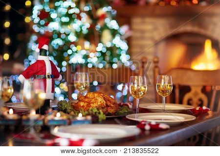 Christmas Dinner At Fire Place And Xmas Tree.