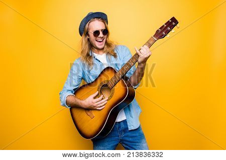 Music Is My Lifestyle! Excited And Carefree Musician Dressed In Casual Clothes And Spectacles Playin