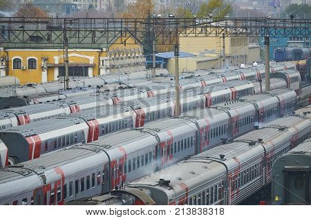 MOSCOW, RUSSIA, OCT,26, 2017: Russian Railways passenger trains in Rizhskaya depot under maintenance. Passenger train lines. RZD passenger coaches cars. Train coaches roofs. European Russian rail