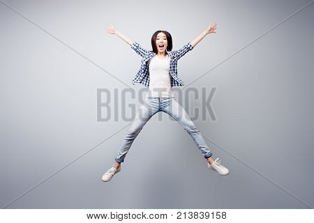 Concept Of Careless And Madness. Crazy Asian Young Girl Is Having Fun. She Is Dressed In Checkered S