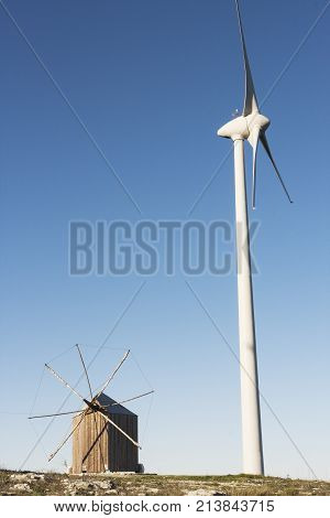 Rare and traditional Portuguese windmill built in wood with the particularity to turn on itself to capture wind side by side with a modern windmill to produce eolic energy