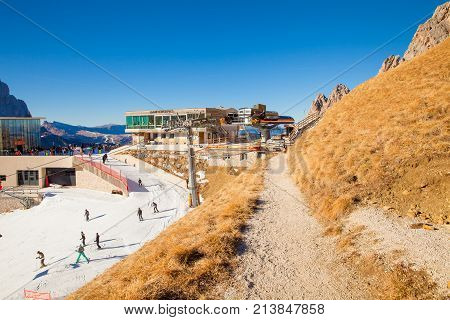 December 2015 Siusi Alp in Italy This is the arrival of the Siusi Alp Gondola in the north of Italy that takes tourists to this artificially snowy trail because it has not yet snowed.