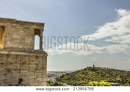 close-up view of the buildings of the Acropolis and behind the monument to Philopappos on the hill of the same name athens