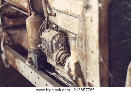 Close up of an old antique tractor engine shallow focal length