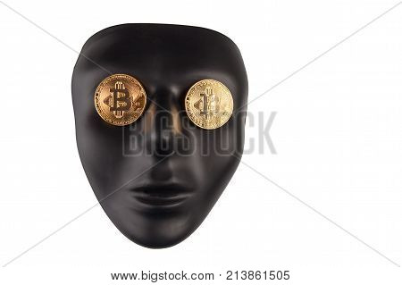 Black face mask with golden bitcoins placed on eyes isolated on white with copy space. Anonymity and cryptocurrency concept