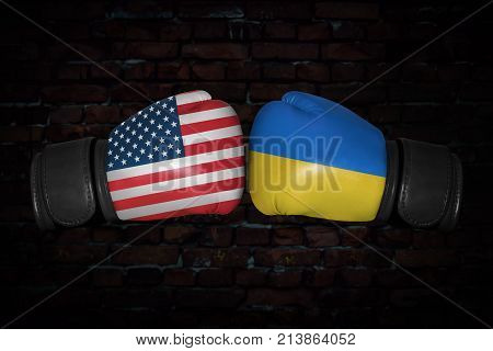 A boxing match. Confrontation between the USA and Ukraine . Ukrainian and American national flags on Boxing gloves. Sports competition between the two countries. Concept of the foreign policy conflict poster