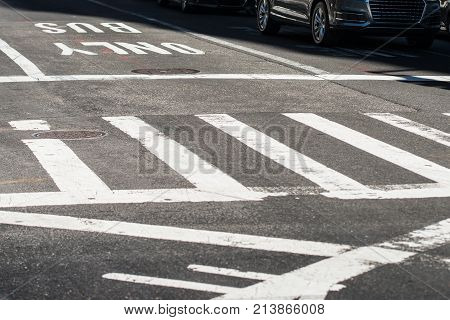 Crosswalk in the city street intersection asphalt road with marking lines and signs