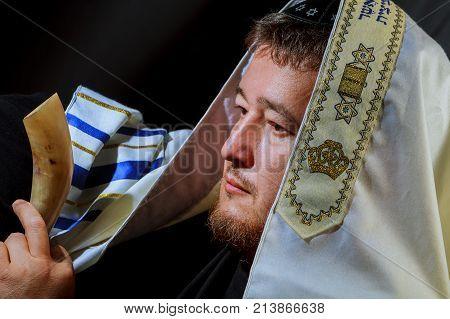 Jewish Man Blowing The Shofar Horn Of Rosh Hashanah New Year