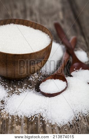 Bowl With Sugar And A Wooden Spoon