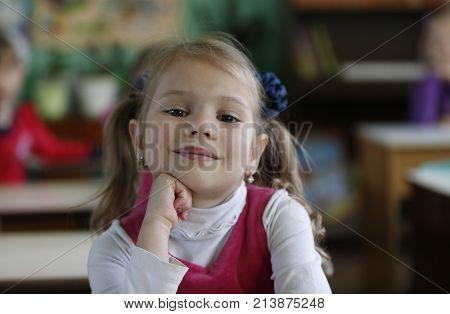 Belarus the city of Gomel May 16 2016. Kindergarten Volotovskaya. Little girl the child is sitting in the kindergarten at the table smiling.Pre-school girl
