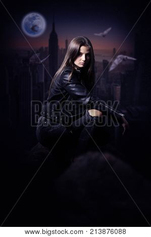 Beautiful Mysterious woman in black leather jacket overlooking the city during the night .Fantasy woman. Book cover.