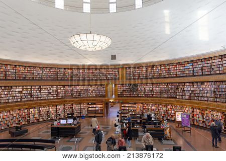 STOCKHOLM OCT 30 2017: People in the city library in Stockholm called Stadsbiblioteket in beautiful central rotunda. October 30 2017 Stockholm Sweden.