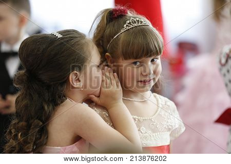 Belarus, The City Of Gomel, May 26, 2016. Kindergarten Volotovskaya.on The Holiday, A Girl Whispers