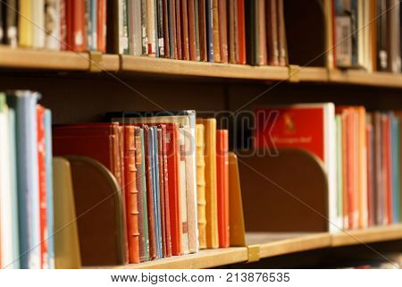 STOCKHOLM OCT 30 2017: Closeup of books in a shelf in the city library in Stockholm called Stadsbiblioteket. October 30 2017 Stockholm Sweden.