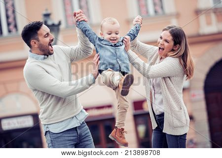 Happy young family spending time together outside.Happiness and harmony in family life. Happy family concept.