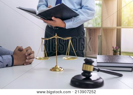 Judge gavel with scales of justice Business people and male lawyers discussing contract papers at law firm in office. Concepts of law. poster