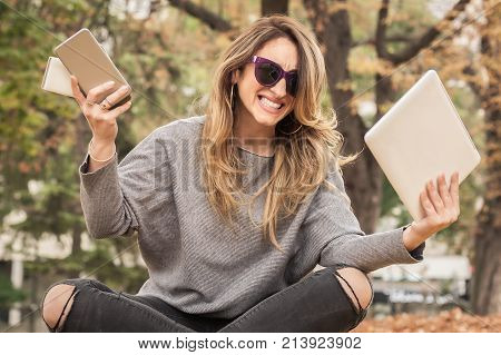 Hysterical Girl With Too Many Screens, Mobils, Tablets And Laptops